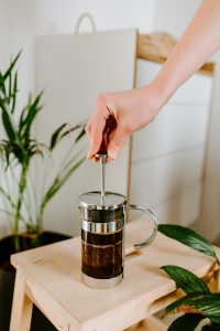 pressing plunger down french press
